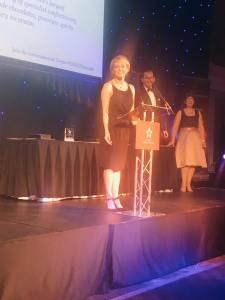 Toni accepting her award